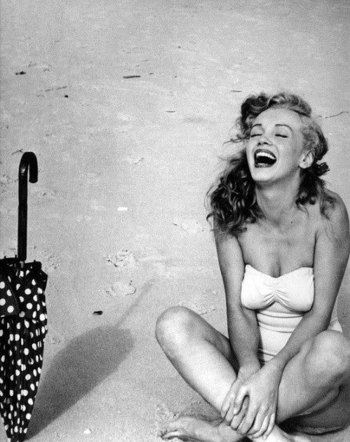 Marilyn Monroe on The Beach, Possibly Happy and Laughing with a Parasol Umbrella
